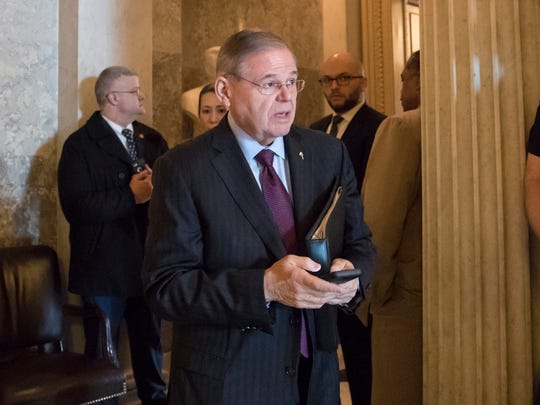 "Sen. Bob Menendez, D-N.J., leaves the chamber after a speech which criticized President Donald Trump's immigration policy and supported ""Dreamers,"" young immigrants helped by the Obama-era Deferred Action for Childhood Arrivals program, at the Capitol in Washington, Wednesday, Feb. 14, 2018."