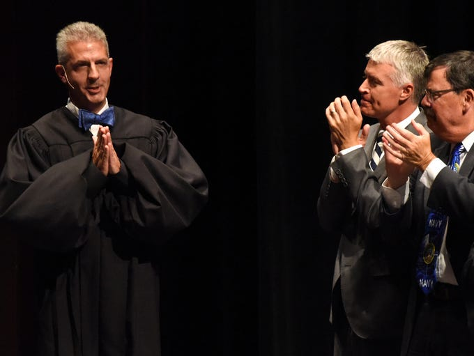 Mark E. Salter celebrates after being sworn in as the
