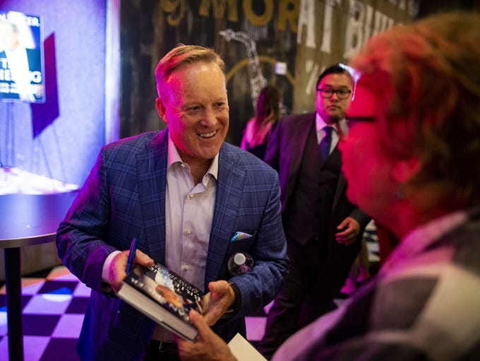 Former White House Press Secretary Sean Spicer signs