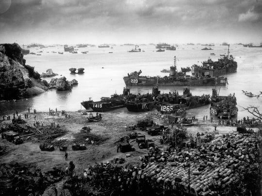 U.S. invasion forces establish a beachhead on Okinawa Island.