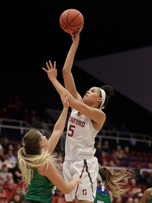 Stanford forward Kaylee Johnson (5) shoots over Florida Gulf Coast guard Taylor Gradinjan during the second half of a second-round game in the NCAA women's college basketball tournament in Stanford, Calif., Monday, March 19, 2018. (AP Photo/Jeff Chiu)