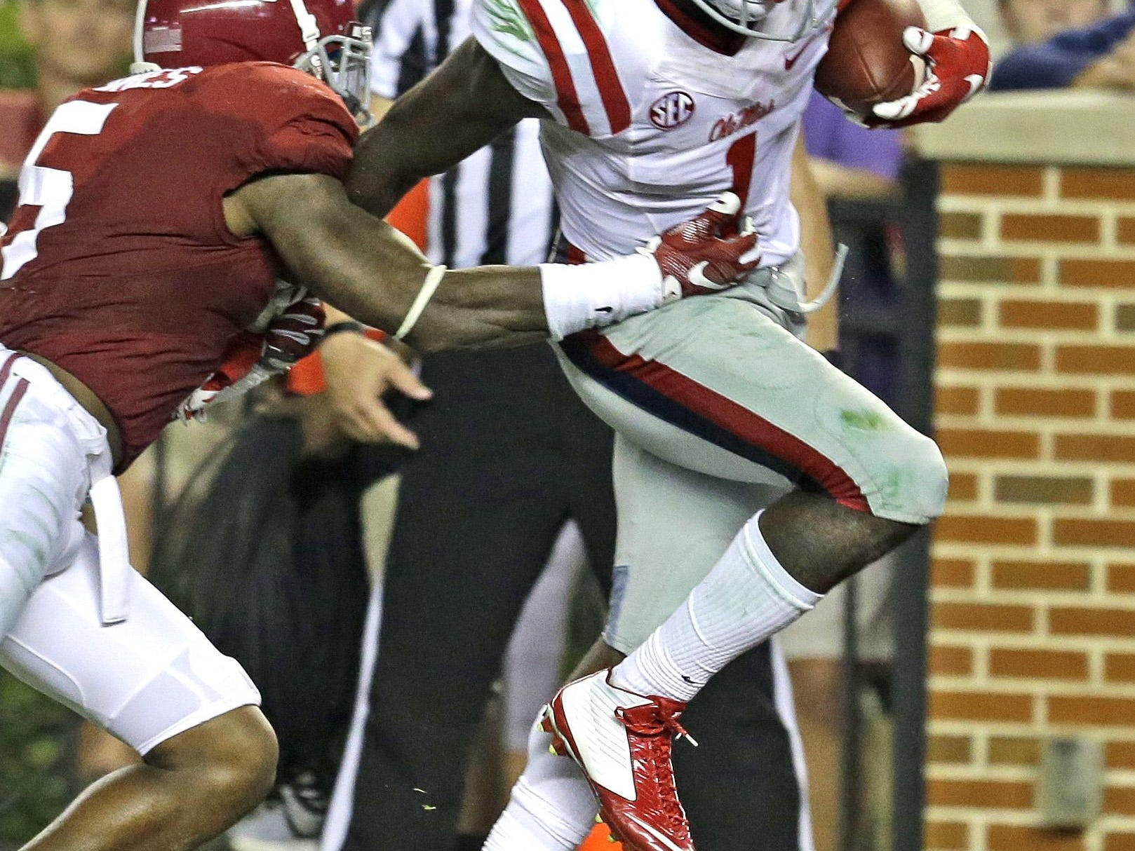 Mississippi wide receiver Laquon Treadwell, right, catches a pass for a touchdown over Alabama defensive back Cyrus Jones, left, during the second half Saturday in Tuscaloosa.