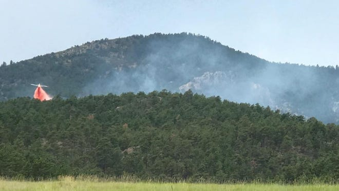 A single-engine air tanker, helicopter and fire crews from Lyons, Loveland and Berthoud responded on Sunday, July 23, 2017, to a 1-5 acre fire southwest of Carter Lake, referred to as the Chimney Hollow Fire.