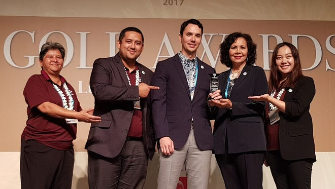 The Guam Visitors Bureau received the Pacific Asia Travel Association Gold Award for its 2016 Shop Guam e-Festival Mobile Campaign in the Marketing Media – Mobile Travel Application MA category. From left: Nadine Leon Guerrero,  marketing manager -- China; Mark Manglona, marketing manager -- North America and Pacific; Nathan Denight, president and CEO; Pilar Laguaña, director of global marketing; and Bonnie Chen, account director – China.