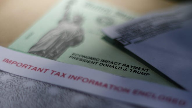 This April 23, 2020, file photo shows President Donald J. Trump's name printed on a stimulus check issued by the IRS to help combat the adverse economic effects of the new coronavirus outbreak in San Antonio.