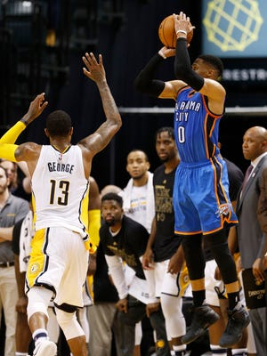 Feb 6, 2017; Indianapolis, IN, USA; Oklahoma City Thunder guard Russell Westbrook (0) misses a game tying shot at the buzzer in the fourth quarter against Indiana Pacers forward Paul George (13) at Bankers Life Fieldhouse.