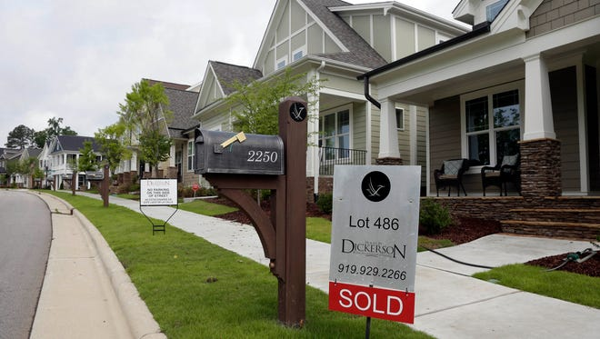 In this Tuesday, June 9, 2015, file photo, a sold sign is displayed in the yard of a newly constructed home in the Briar Chapel community in Chapel Hill, N.C. On Thursday, Jan. 28, 2016, Freddie Mac reports on the week's average U.S. mortgage rates.