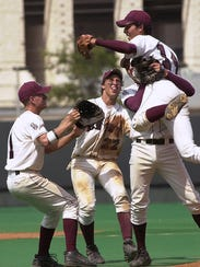 Sinton celebrates after the last out in the top of