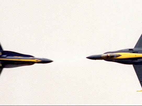 Two F/A-18 Hornets of the Blue Angels flying team perform