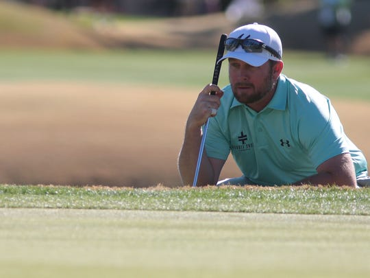 Steve Wheatcroft prepares to putt on the 18th on the Nicklaus Private Course during the third round of the Humana Challenge on Saturday, January 24, 2015 in La Quinta.