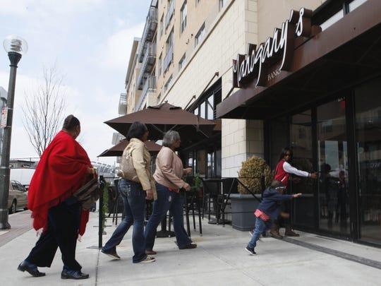 Customers visit Mahogany's on Saturday.