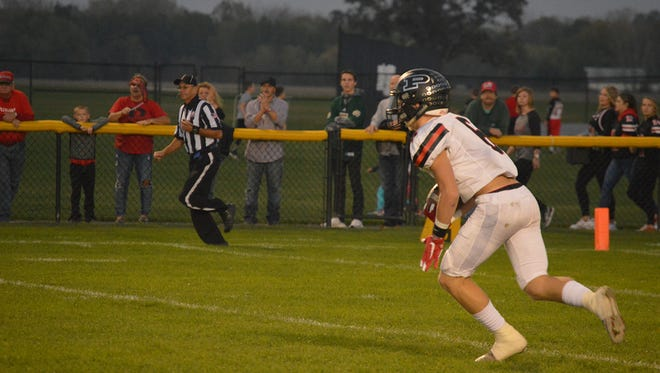Pleasant's Patrick Blubaugh sets up a return during last week's 27-14 win at River Valley. The Spartans face Clear Fork Friday night at home in a meeting of unbeatens.