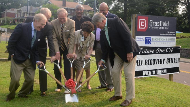 Aspell Recovery Center staff broke ground Tuesday for its new men's dormitory.