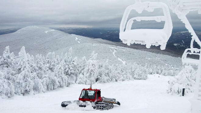 A snow groomer prepares a trail at the Killington Mountain ski resort.