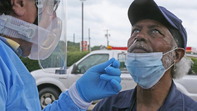Leon Byrd, 63, of Akron, gets tested for COVID-19 in the parking lot of the House of the Lord on Saturday, June 27, 2020, in Akron.  Summit County Public Health and Summa Health partnered with church for the first of several public events to test for COVID-19. will continue  from 11 a.m. to 1 p.m. and 3 to 5 p.m. Sunday, June 28.