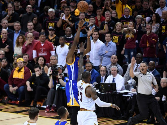 Jun 7, 2017; Cleveland, OH, USA; Golden State Warriors forward Kevin Durant (35) shoots the basketball against Cleveland Cavaliers forward LeBron James (23) during the fourth quarter in game three of the 2017 NBA Finals at Quicken Loans Arena. Mandatory Credit: Kyle Terada-USA TODAY Sports