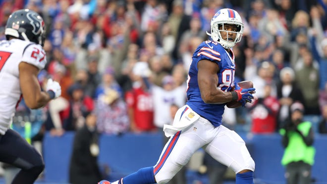 A wide open Charles Clay checks over his shoulder on his way to the game winning 40 yard touchdown reception.  The Bills beat the Texans 30-21.