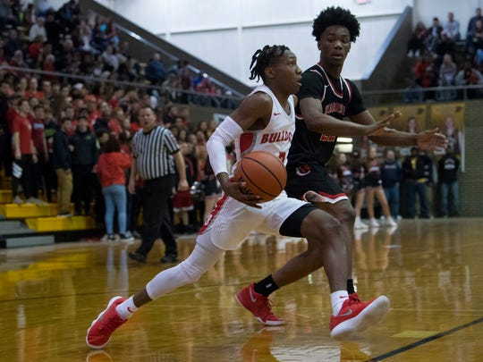 Bosse's Mekhi Lairy (2) drives past Harrison's Isaiah Edinburgh (22) during the SIAC Championship game at Central High School Saturday night. Bosse beat Harrison 106-63.