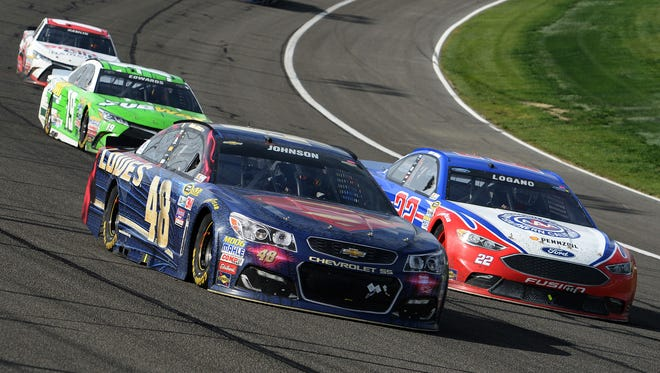 Jimmie Johnson (48) and Joey Logana (22) race for the lead during the late laps of the NASCAR 400 mile auto race Sunday at Auto Club Speedway in Fontana, Calif.