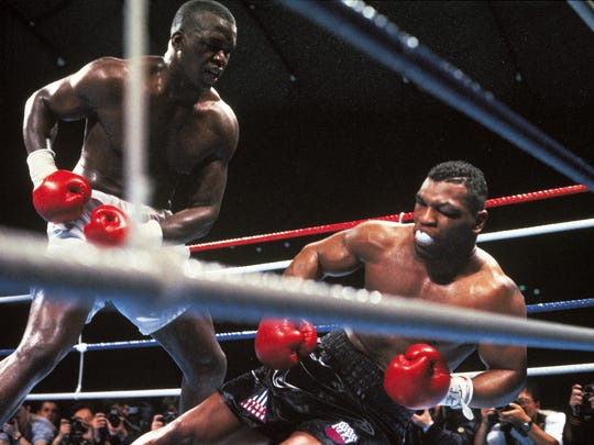 This handout photo shows Mike Tyson, right, fighting Buster Douglas on Feb. 11, 1990, in Tokyo.