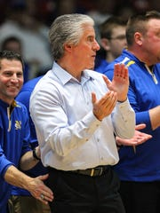 Ron Dawn, white shirt, and assistant coaches applaud the team's effort during NewCath's 69-48 win in the State All A Classic in Frankfort, Thursday, January 28, 2016.