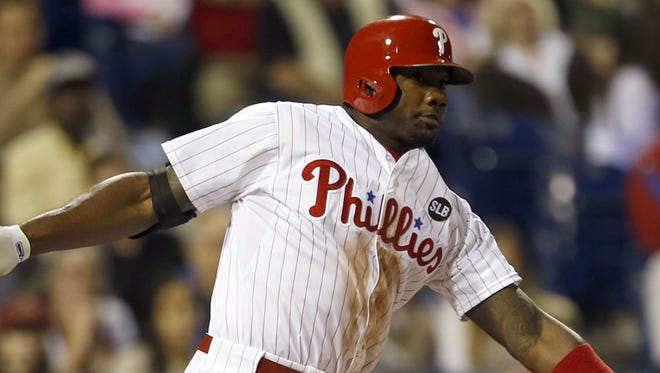The Philadelphia Phillies' Ryan Howard watches his RBI double against the Arizona Diamondbacks at Citizens Bank Park in Philadelphia on May 15, 2015.