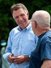 Republican candidate for governor Lt. Gov. Phil Scott, left, chats with Steve Kimball of New Haven during a campaign visit at Maple Landmark Woodcraft in Middlebury on Wednesday, June 1, 2016.