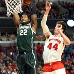 Branden Dawson, here dunking in front of Wisconsin's Frank Kaminsky in the Big Big Ten tournament championship in March, was selected by New Orleans 56th in the NBA draft Thursday night and immediately traded to the Los Angeles Clippers.