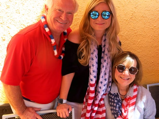 """Dr. Larry Allen, Meredith Allen, Lori Allen host their table on Pepi's Deck at """"Vail America Days"""" July 4th Parade."""
