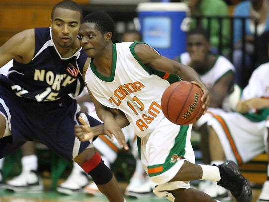 FAMU's Byron Taylor (10) drives past North Florida's Cortez Riley (15) as the Rattlers host the North Florida Osprey  on Saturday December 15, 2007. FAMU wins 61-57.