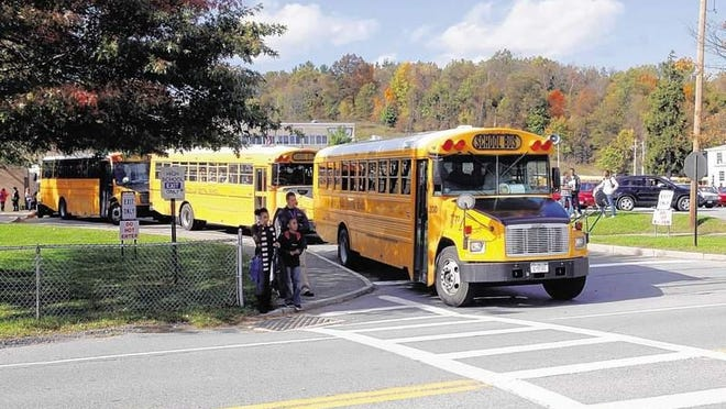 Buses leave Washingtonville High School.