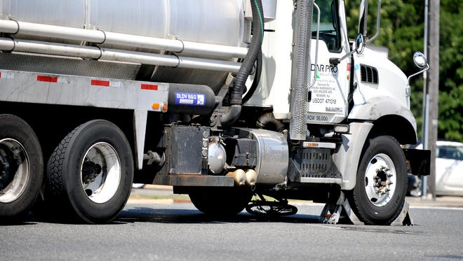 A bicycle is pinned under a commercial truck on Delsea Drive Tuesday, Aug. 9, 2016 in Vineland.