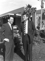 This undated file photo shows actor and singer Frank Sinatra, left, with former president John F. Kennedy.