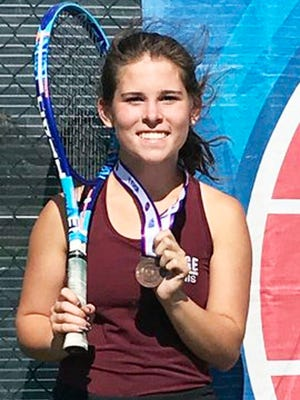 Osage's Lily Davis with her eighth place state medal in the Class 1 state singles tournament on Saturday, October 17, in Springfield.
