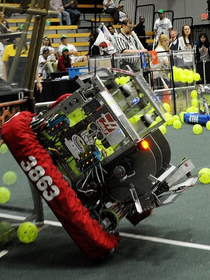 A robotic machine is hoisted as teams face off in the 2017 FIRST Robotics regional competition at Ventura College.