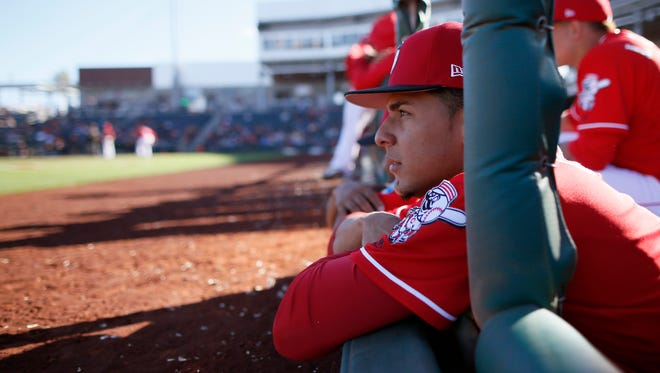 Cincinnati Reds relief pitcher Luis Castillo (58) watches the action from the dugout in the bottom of the eighth inning of the MLB Spring Training game between the San Francisco Giants and the Cincinnati Reds at Goodyear Ballpark in Goodyear, Ariz., on Sunday, Feb. 26, 2017. The Reds fell to 0-3 in spring training with a 9-5 loss to the Giants.