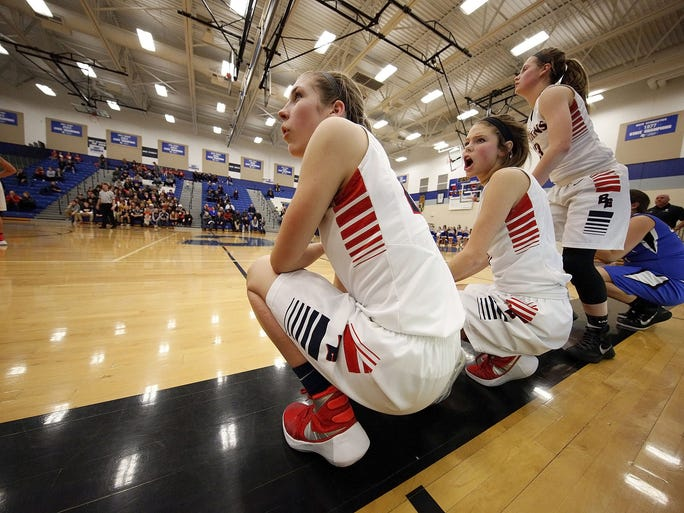 Brookfield East's Molly DeValkenaere,(left)  Cami Cross, (center), and Jen Wendt (right) wait to enter their varsity teams W.I.A.A. Sectional Game against Oak Creek in Brookfield Central High School Thursday, March 3, 2016, in Brookfield, Wisconsin.