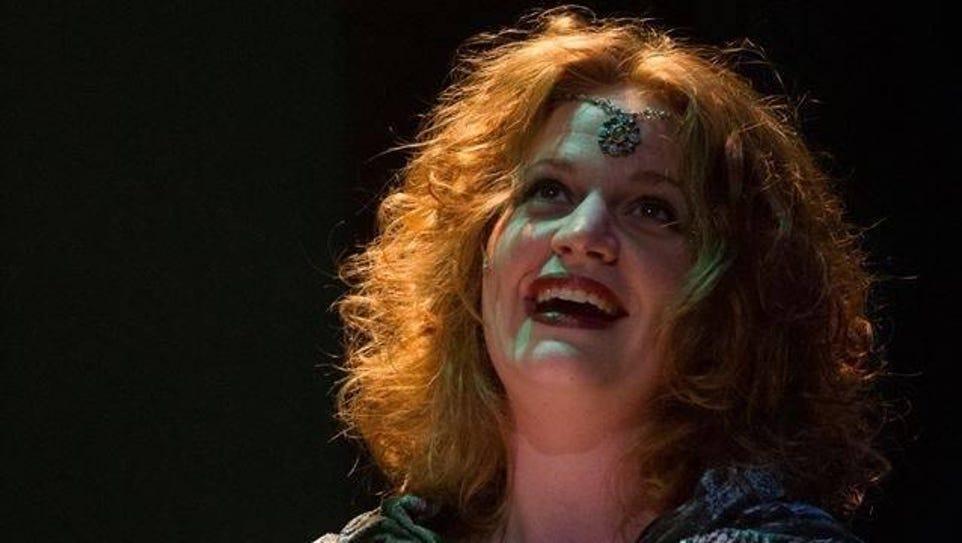 The enchantress Morgan Le Fay fights King Arthur for