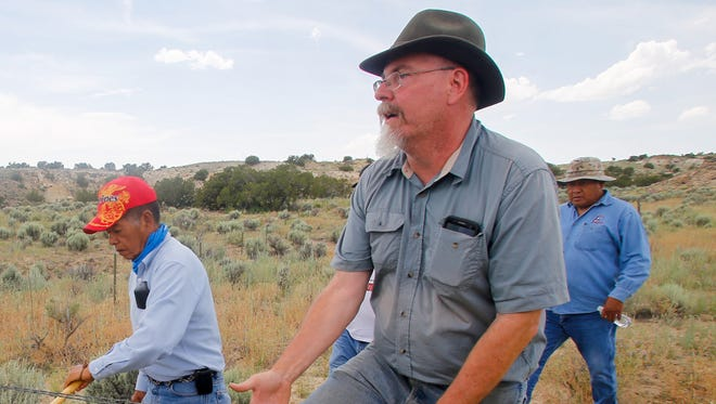Paul Reed, right, a preservation archaeologist with Archaeology Southwest, leads a tour June 23 at Pierre's Ruin north of Chaco Culture National Historical Park.
