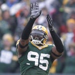 Green Bay Packers defensive end Datone Jones (95) dances after casing a Detroit Lions safety in the fourth quarter during Sunday's game at Lambeau Field.