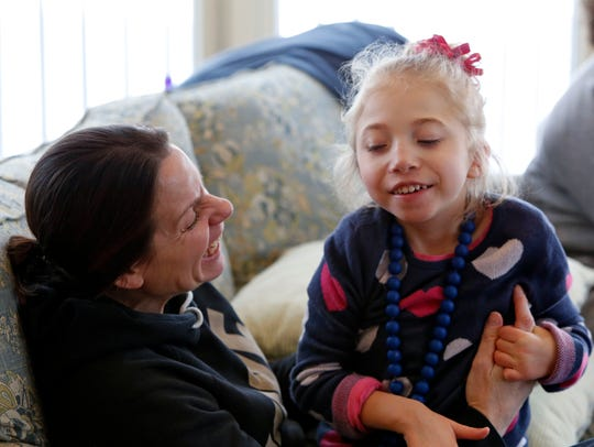 Morgan Jones, 5, with her nurse, Terriann Federighi,