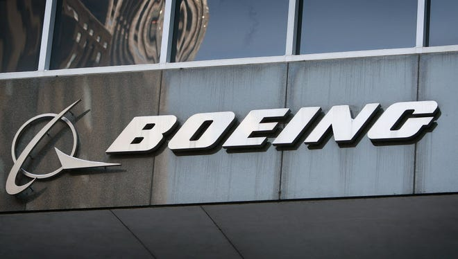 A sign hangs above the entrance to The Boeing Co.'s headquarters on Jan. 28, 2009 in Chicago, Ill.