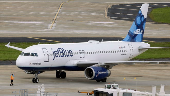 A JetBlue Airways Airbus A320-232 pushes back from the gate at the Tampa International Airport in Tampa, Fla., on May 15, 2014.