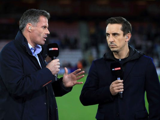 FILE - In this file photo dated Sept. 15, 2017, Sky Sports commentators Jamie Carragher, left, and Gary Neville, at Bournemouth, England.  Former Liverpool defender Jamie Carragher was suspended as a soccer analyst by the Sky television network on Monday March 12, 2018, after being filmed spitting in the direction of a 14-year-old girl through his car window. (John Walton/PA via AP)