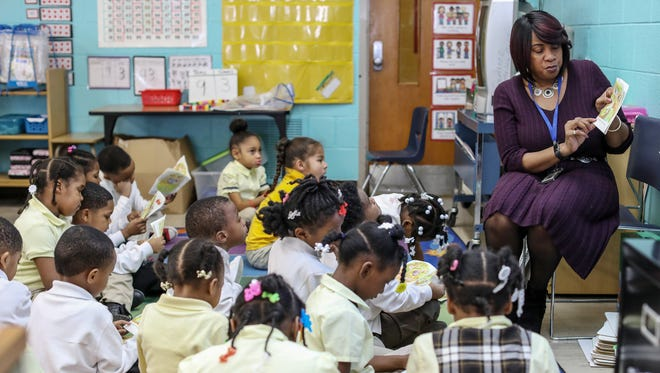 Vanessa Parnell reads along with her kindergarten class of 38 students at Palmer Park Preparatory Academy in Detroit.