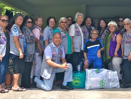 Members of the Guam Sunshine Lions Club, in fulfilling