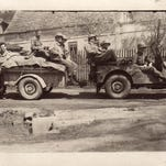 "At far left, Andy Andrews stands with his squad and a Jeep they named ""Little Joe."""