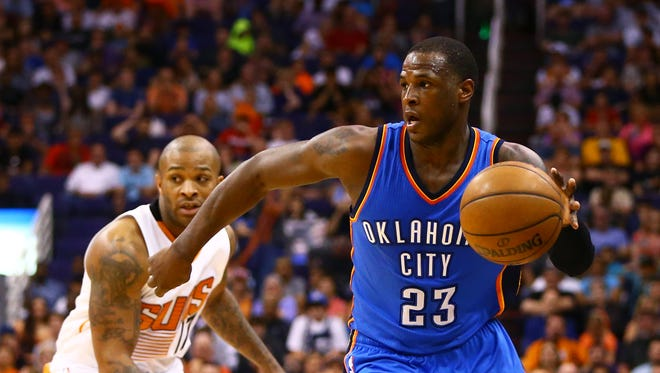 Oklahoma City Thunder guard Dion Waiters controls the ball in the fourth quarter against the Phoenix Suns at US Airways Center.