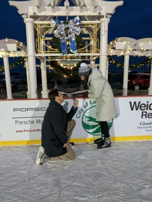 Maylon Campbell and joe Torrisi at the Pier Village ice rink.