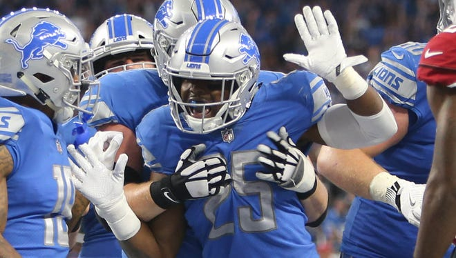 Theo Riddick (25) celebrates his touchdown against the Cardinals in the third quarter of the Lions' 35-23 win Sunday, Sept. 10, 2017 at Ford Field.